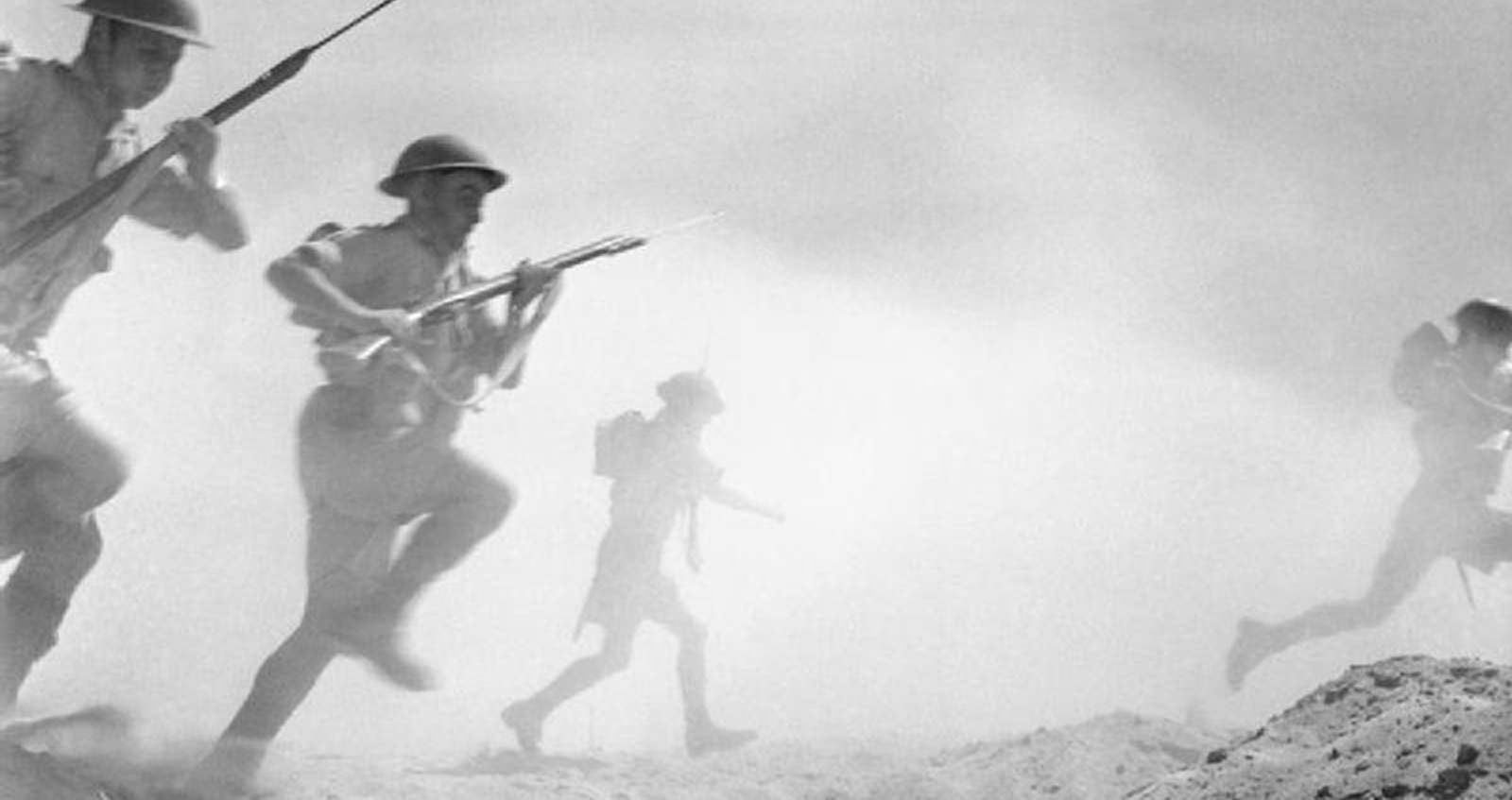 Soldiers advancing over ground at El Alamein