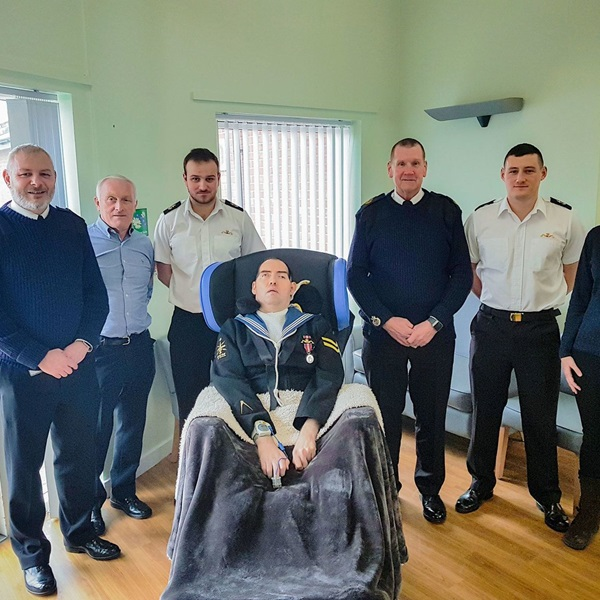 The Legion and Navy representatives present the Reynolds' with Paul's wheelchair
