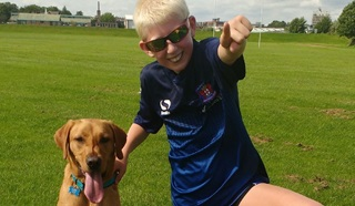 Jake with Autism assistance dog Rigby in the park