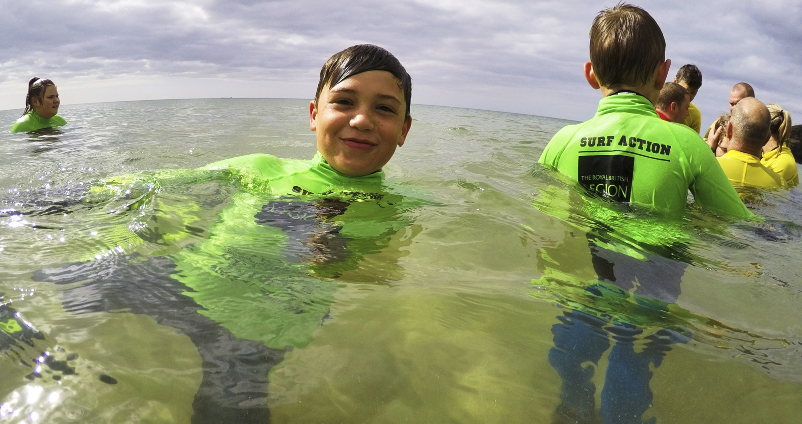 Children in the water at a Surf Action surf session