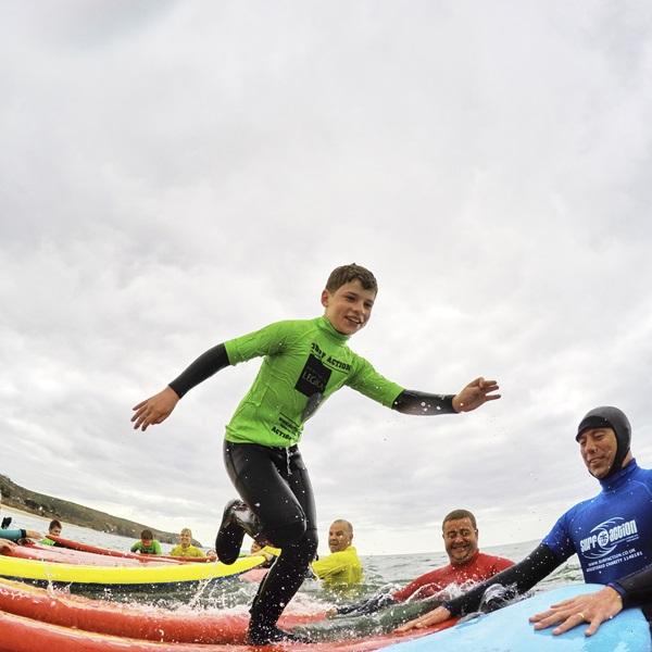 Children taking part in a surf lesson