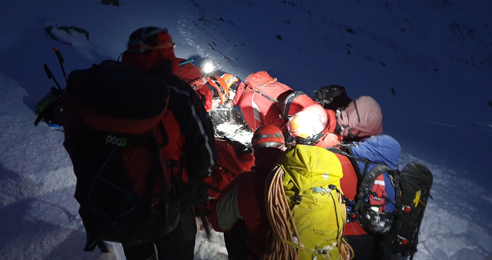 The RAF mountain rescue team helping an injured walker of Mount Snowdon