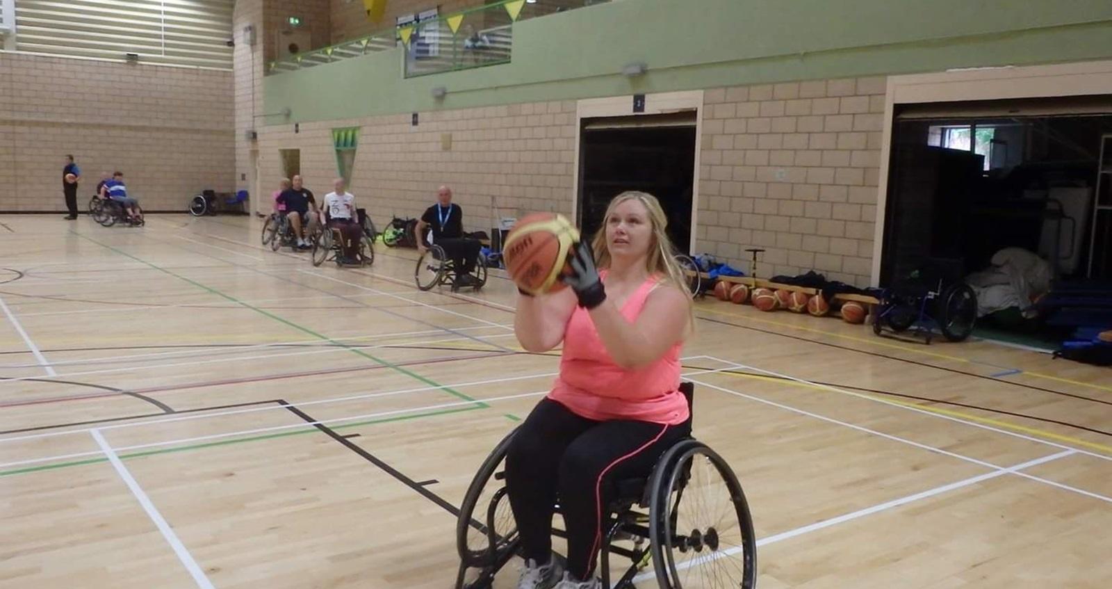 Naomi playing wheelchair basketball