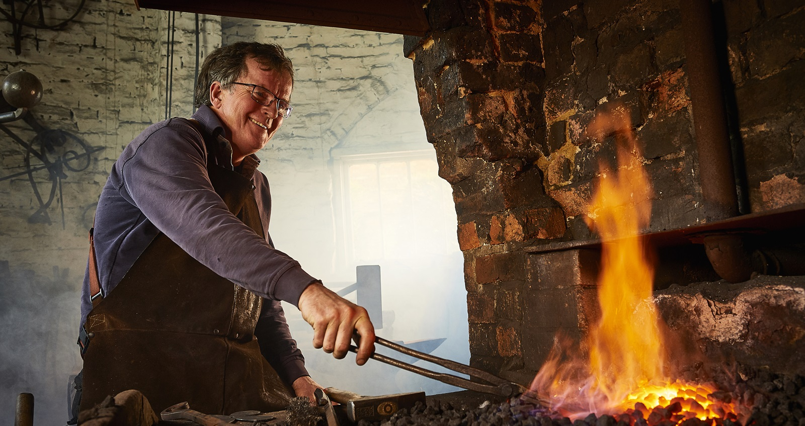 Veteran Tim Mackareth in his blacksmith workshop