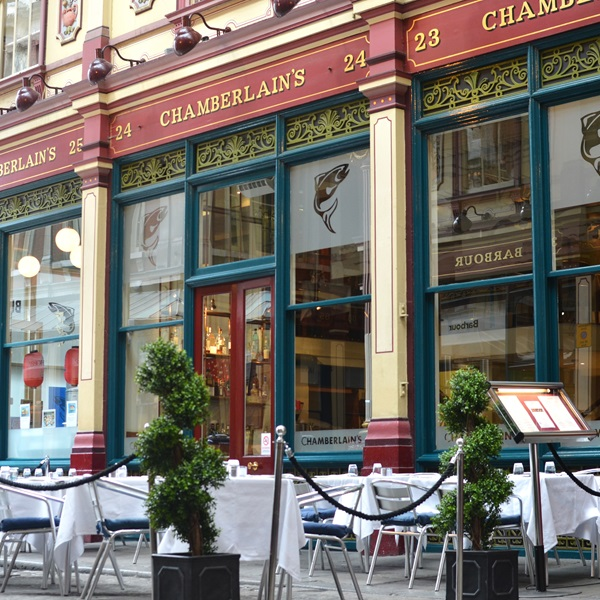 The exterior of Chamberlain's restaurant with tables set outside