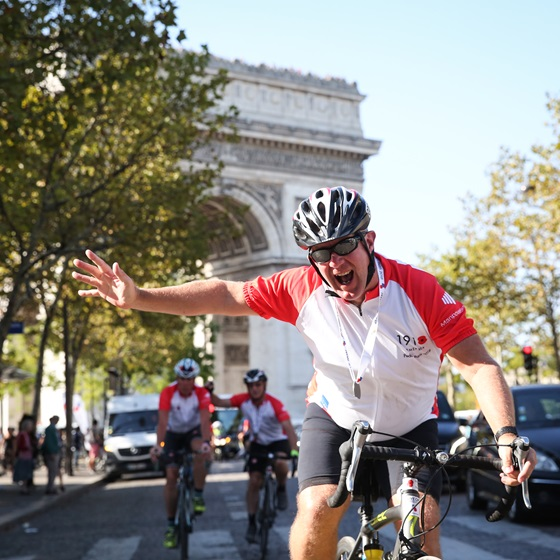 Cyclist waving at Pedal to Paris 2018