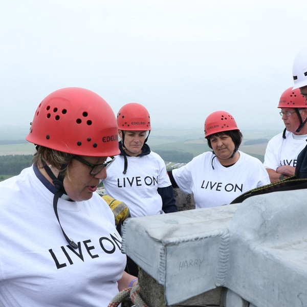 Group wearing Live On t-shirts about to abseil for the Legion