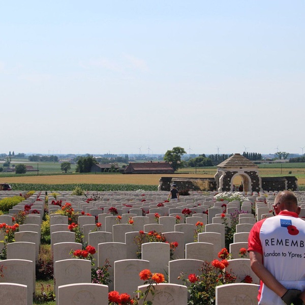 Cyclist from Pedal to Ypres ride at a graveyard in Ypres