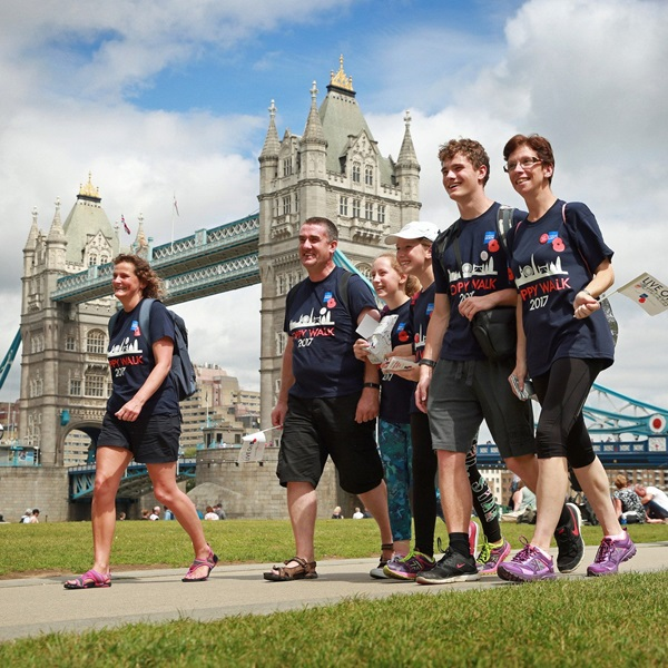 Poppy Quest London group walking past Tower Bridge.