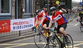 Cyclists from the Legion's Prudential Ride London turning a bend