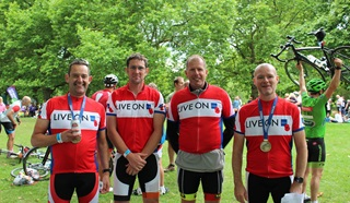 Prudential RideLondon team photo wearing the Legion's 'Live On' t-shirts and wearing medals