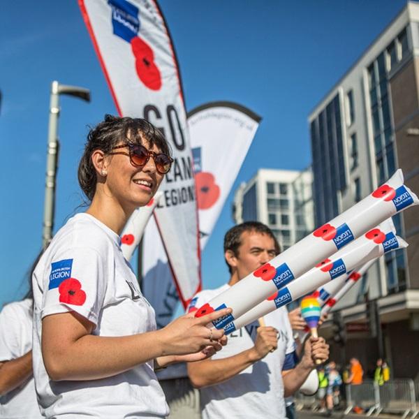 A Legion cheer team volunteer at a biking event