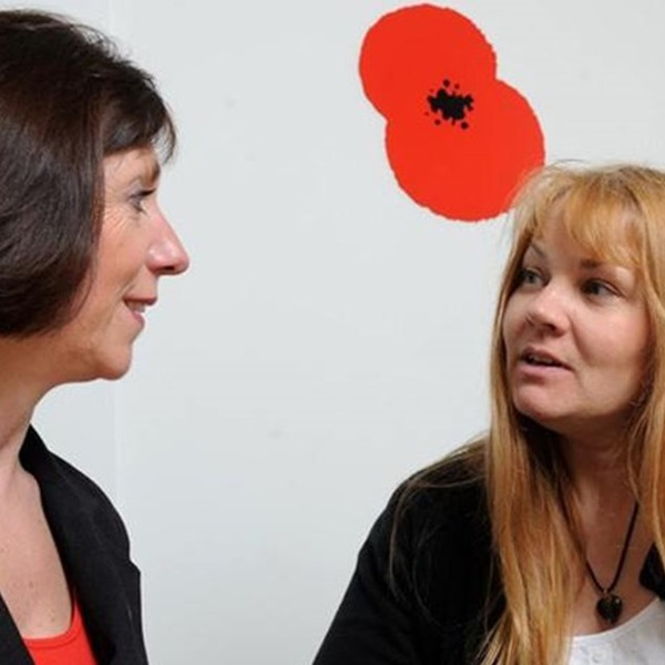 Two women discussing the Legion's free will writing service