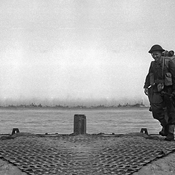 Soldiers walking on the shores of Normandy