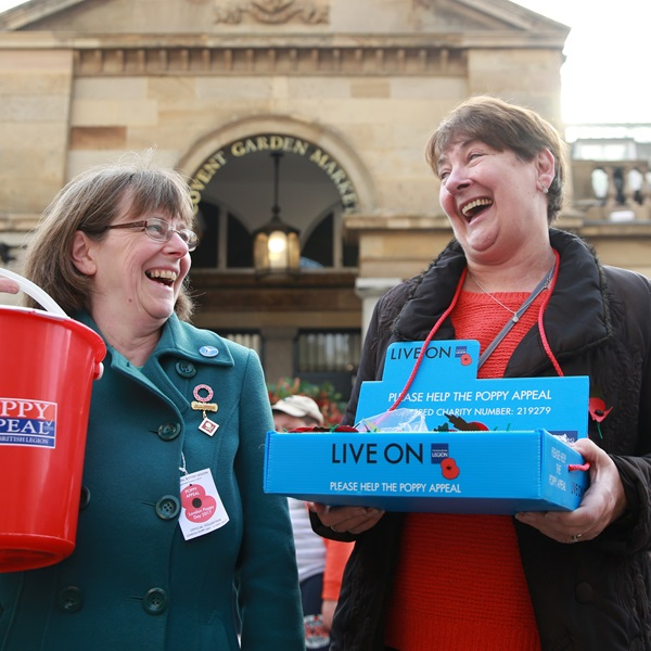 Poppy Appeal volunteers selling the Legion's paper poppies at Covent Garden Market
